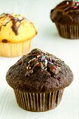 Chocolate Muffins On Kitchen Table