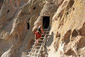 Woman Exploring Cliff Dwellings