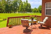 stock photo of lawn chair  - Residential backyard deck overlooking lawn and lake - JPG