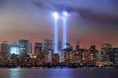 image of tribute  - New York City Manhattan downtown skyline at night from Liberty Park with light beams in memory of September 11 viewed from New Jersey waterfront - JPG