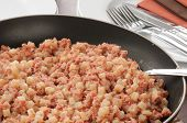 stock photo of hash  - Closeup of a frying pan full of corned beef hash - JPG