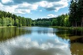 foto of dam  - small water water reservoir with blue sky - JPG
