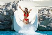 Happy Blond Girl Sliding In Aquapark