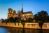 Picture of notre dame de paris cathedral and seine river in the evening, paris, france.