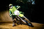 stock photo of motocross  - Enduro bike rider on action. Turn on sand terrain.