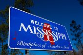 Welcome to Mississippi road sign with a blue sky background