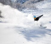 Snowboarder Racing Down