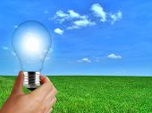 stock photo of reprocess  - Eco light bulb solar renewable energy concept - JPG