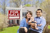 stock photo of yard sale  - Happy Couple in Front of For Sale Real Estate Sign and New House - JPG