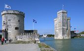 LA ROCHELLE, FRANCE - JUNE 24: Towers of ancient fortress in La Rochelle, France on June 24, 2013. The chain between towers served to close the Old Port in Middle Ages