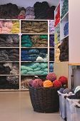 picture of armoire  - Carpet atelier closets and boxes with colorful skeins and threads