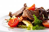 stock photo of roasted pork  - Veal and Mushrooms Salad with Mixed Salad Leaves and Cherry Tomato - JPG