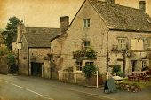small cafe in Bibury, Gloucestershire, England.  Photo in retro style. Paper texture.