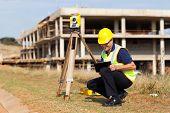 middle aged land surveyor working outdoors