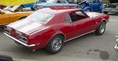 Red And White 1968 Chevy Camaro 327 Rear View
