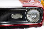 Red And White 1968 Chevy Camaro 327 Headlamp
