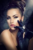 Beauty Fashion Girl Portrait. Vintage Style Girl Wearing Gloves. Jewellery. Hairstyle and Make-up. Diamond Ring. Retro Woman Portrait