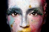 stock photo of extreme close-up  - Extreme Make Up Cosmetics on a Beautiful Woman - JPG