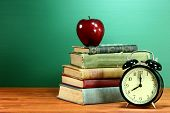 Back to School Books, Apple and Clock on Desk