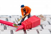 stock photo of groping  - a worker repairs a network cable - JPG