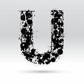 Letra U, formada por manchas de tinta