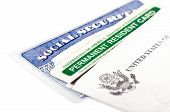 pic of illegal  - United States of America social security and green card on white background - JPG