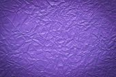 Crumpled Paper Background In Purple Color