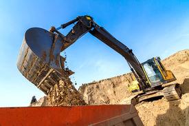 picture of dumper  - Excavator Loading Dumper Truck at Construction Site - JPG