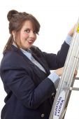 Young business woman climbing the business ladder; isolated