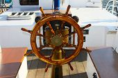 Ship steering wheel and navigation compass
