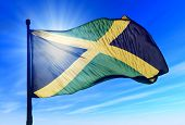 image of greater antilles  - Jamaica flag waving on the wind on the sky - JPG