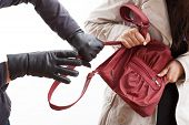 picture of yanks  - A closeup of a thief wearing gloves holding a woman - JPG