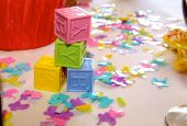 stock photo of mutilated  - A photo of baby shower block and confetti - JPG