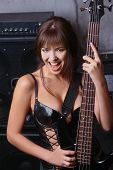 busty girl with guitar