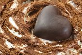 Chocolate Heart On Ice Cream Cake With Cream And Cocoa