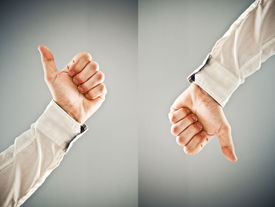 image of disapproval  - Businessman showing thumb down and thumb up symbol - JPG