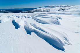 image of bogong  - Windswept snow and view to Mt Bogong from above Falls Creek - JPG