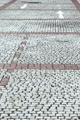 Cobblestone Pavement With White Arrows