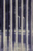 Metal Grid In Front Of A Glass Door