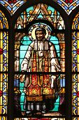 PARIS, FRANCE - NOV 11, 2012: Saint Vincent de Paul, stained glass from Church of St-Germain-l'Auxer
