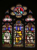 PARIS, FRANCE - NOV 11, 2012: Judith (top), Manasseh, ?, Jonathan, stained glass from Church of St-Germain-l'Auxerrois founded in the 7th century, was rebuilt many times over several centuries.
