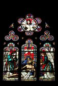 PARIS, FRANCE - NOV 11, 2012: Pieta, stained glass from Church of St-Germain-l'Auxerrois founded in