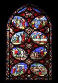 PARIS, FRANCE - NOV 11, 2012: Scenes from the life of the Christ, stained glass from Church of St-Ge