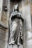 PARIS, FRANCE - NOV 11, 2012: Saint Joan of Valois statue, Church of St-Germain-l'Auxerrois founded