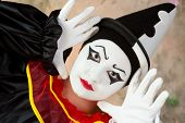 Female mime artist in pierrot clown disguise