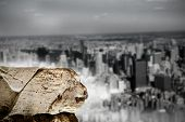 Digitally generated large rock overlooking huge city