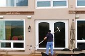 foto of window washing  - Professional window washer cleaning house windows with de - JPG