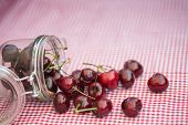Glass Storage Jar Full Of Fresh Cherries