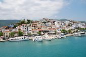 SKIATHOS, GREECE - JUNE 14, 2013: Boats moored in the harbour at Skiathos Town on the Greek island o