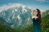 Beautiful Girl Enjoying  Valley View Nature Over Mountain Landscape. Travel. Happy Woman Feels Good,